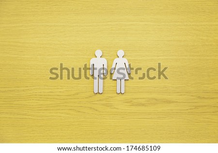 Toilets Sign on a wooden door, detail of a signal information in a public wc - stock photo