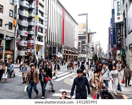 TOKYO -APR 14: crowd at Ginza Sunday walking street on Apr 14, 2013 in Tokyo, Japan. Ginza is recognized as one of the most luxurious shopping districts in the world.