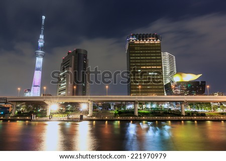 TOKYO - APR 10: Tokyo Sky tree and Asahi Beer Hall on Apr 10, 2014 in Sumida. It's a famous tourist destination in Tokyo where is close to Senso-Ji temple. - stock photo