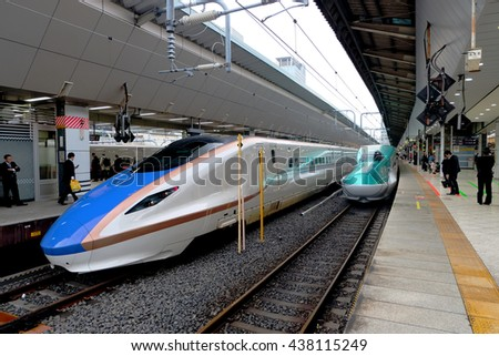 TOKYO, 6 April 2016  : E7 and E5 Series Shinkansen high-speed bullet train operated by JR East at the Tokyo (after the rain weather) - stock photo