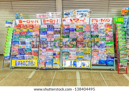 TOKYO - APRIL 9 : Free Japanese magazine at  Shinjuku station, Tokyo on April 9, 12. With more than 1.5 million passengers per day, Shinjuku is the biggest station in the world. - stock photo