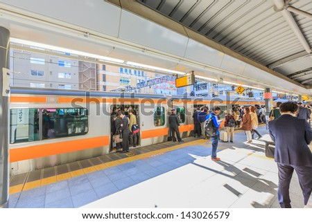 TOKYO- APRIL 12 : JR Orange line trains at Uaeno station in April 12, 13, The Japan Railways took over most of the assets and operations of the government-owned Japanese National Railways . - stock photo