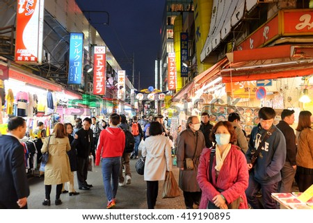 TOKYO- APRIL 1, 2016:  the Ameyoko shopping street in Ueno district,Tokyo Japan.This market is various products such as clothes, bags, cosmetics, fresh fish, dried foodare sold along Ameyoko.