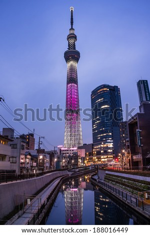 TOKYO - APRIL 13: View of Tokyo Sky Tree at dusk on April 13, 2014 in Tokyo, Japan. It is the highest free-standing structure in Japan and 2nd in the world with over 10million visitors each year. - stock photo