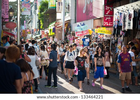 TOKYO - AUGUST 5 : People, mostly youngsters, walk through Takeshita Dori near Harajuku train station on August 5, 2012. Takeshita Dori is considered a birthplace of Japan's fashion trends.