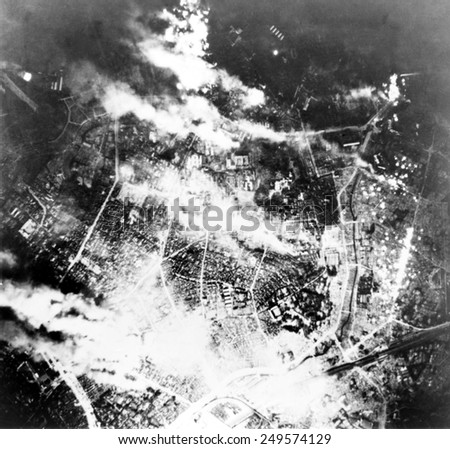 Tokyo burns under B-29 firebomb assault. In this raid, 464 B-29s fire bombed the area immediately south of the Imperial Palace. May 26, 1945. - stock photo