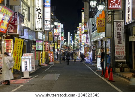 TOKYO - CIRCA NOVEMBER 2014. Despite reports of a slowing Japanese economy, the neon lights of Shinjuku reflect a vibrant hub of retail and commercial business, restaurants and entertainment. - stock photo