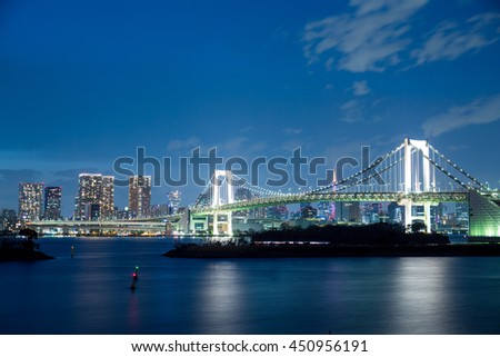 Tokyo city and rainbow bridge at twilight