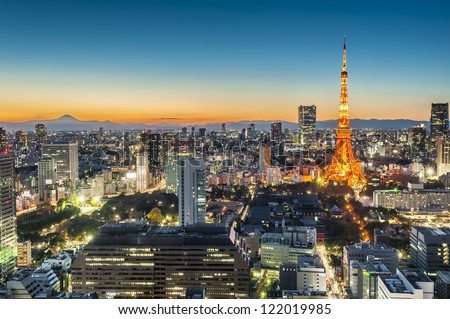 Tokyo city at twilight with Mt Fuji on the background - stock photo