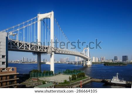 Tokyo City - Rainbow Bridge at sunny day - stock photo