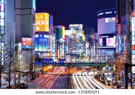 TOKYO - DECEMBER 29: Billboards in Shinjuku's Kabuki-cho district December 29, 2012 in Tokyo, JP. The area is a nightlife district known as Sleepless Town. - stock photo