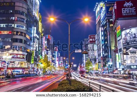 TOKYO - DECEMBER 29: Billboards in Shinjuku's Kabuki-cho district December 29, 2012 in Tokyo, JP. The area is a popular nightlife district. - stock photo