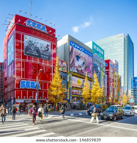 TOKYO - DECEMBER 29: Pedestrians and traffic in the Akihabara distrct December 29, 2012 in Tokyo, JP. The district is a major shopping area for electronic, computer, anime, games and otaku goods. - stock photo