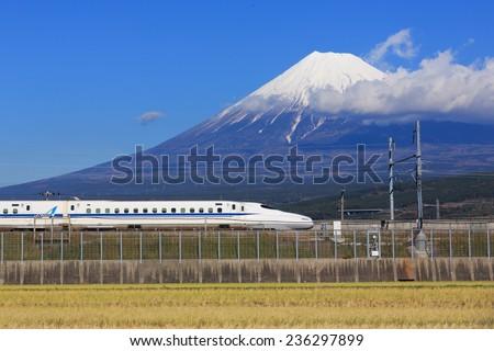 TOKYO - December 6: Shinkansen bullet train at Tokyo railway station in December 6, 2014 Tokyo, Japan. The Tokaido Shinkansen operate between Tokyo and Osaka and stop at Yokohama, Nagoya, Kyoto. - stock photo
