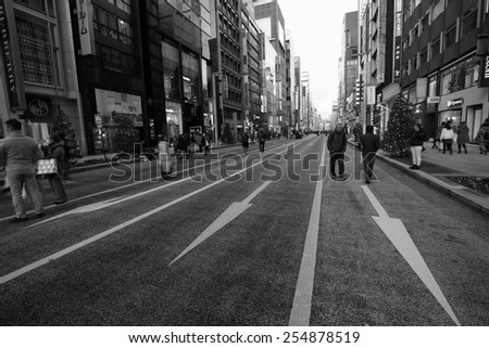 TOKYO - DECEMBER 21, 2014: Shoppers on the main street at Ginza Shopping district in Tokyo, Japan. Ginza is recognized as one of the most luxurious shopping districts in the world.