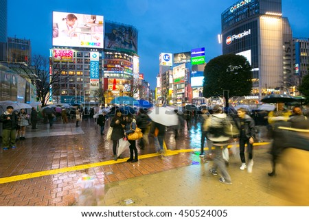 TOKYO-FEB 18: Pedestrians walking at Shibuya on Febuary 18, 2015 in Tokyo, Japan. Shibuya is known as one of the fashion centers of Japan, particularly for young people, and as a major nightlife area. - stock photo
