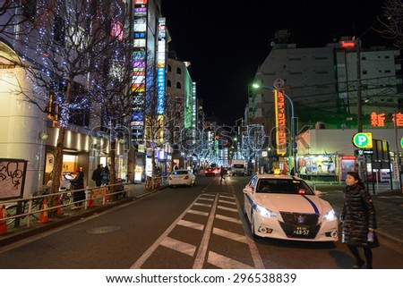 TOKYO - JAN 3: Billboards in Shinjuku's Kabuki-cho district January 3, 2015 in Tokyo, JP. The area is a nightlife district known as Sleepless Town. - stock photo