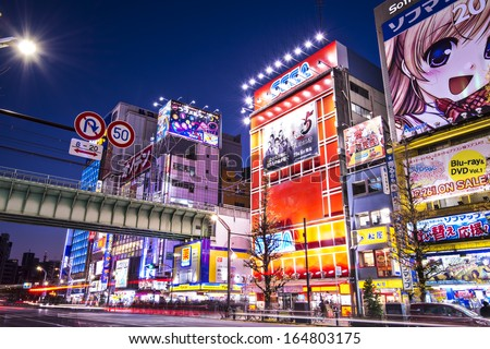 TOKYO - JANUARY 2: Akihabara district January 2, 2013 in Tokyo, JP. The district is a major shopping area for electronic, computer, anime, games and otaku goods. - stock photo