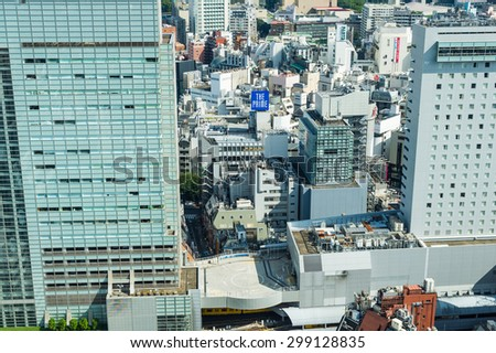 TOKYO - JANUARY 10, 2013: Cityscape view over the Shibuya crosswalk. Shibuya is a famed fashion center and nightlife area. - stock photo