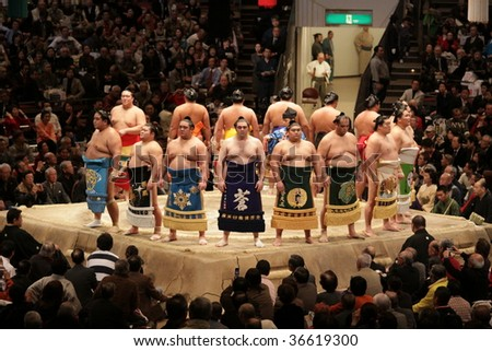 TOKYO - JANUARY 20: High rank sumo wrestlers line up with crowd in the Tokyo Grand Sumo Tournament January 20, 2009 in Tokyo, Japan. - stock photo