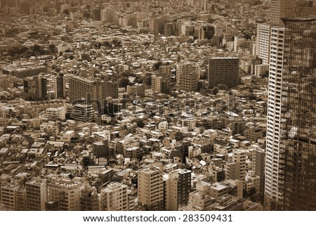 Tokyo, Japan - aerial view of Shinjuku district. Modern city. Vintage style sepia image.