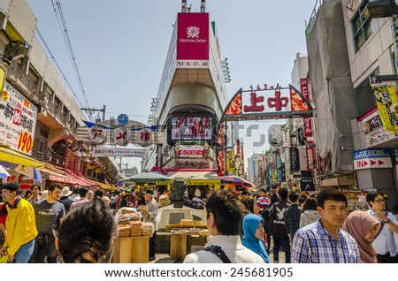 TOKYO,JAPAN - 27 April 2014 :Ameyoko is a busy market street along the Yamanote near Ueno Stations.various products such as clothes, fresh fish, dried food and spices are sold along here - stock photo