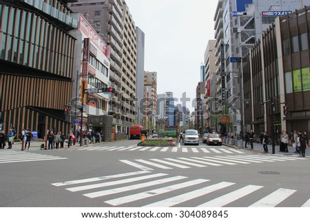 Tokyo, Japan - April 12, 2015: Busy intersection with many crosswalks in front of Sensoji in Asakusa, one of Tokyo's districts, where an atmosphere of the Tokyo of past decades survives.
