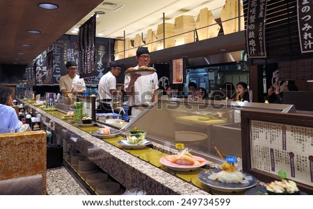 TOKYO, JAPAN - APRIL 14 : Chefs working in sushi restaurant in Tokyo taken April 14, 2014 in Tokyo. Sushi is popular cuisine culture in Japan. - stock photo