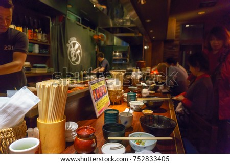 Tokyo,Japan.April 13, 2017. customer is sitting and eating sashimi or japanese seafood inside restaurant of tsukiji fish market.