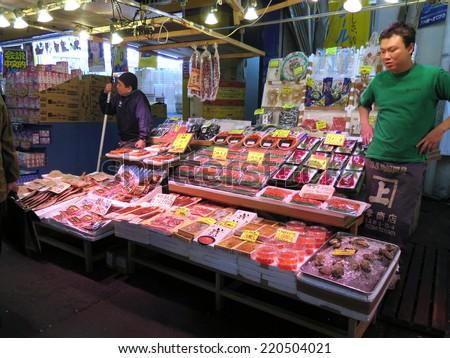 TOKYO JAPAN - APRIL 15 : Fish shop in Ameyoko Street in Ueno district taken April 15, 2014 in Tokyo, Japan. - stock photo