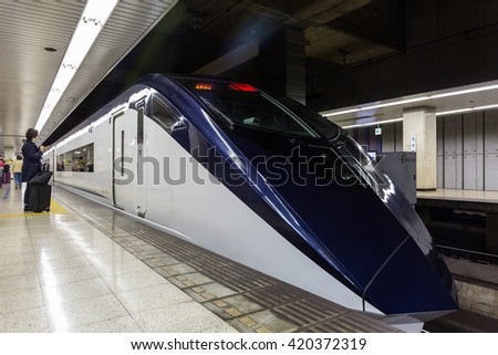 Tokyo, Japan - April 12, 2016: Keisei Skyliner waits for passengers at Ueno terminal to Narita international airport. connecting Narita Airport to the heart of Tokyo in as little as 41 minutes. - stock photo