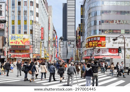 Tokyo, Japan - April 18, 2015: Pedestrians walk at Kabuki-cho district. The area is a entertainment and nightlife district known as Sleepless Town in Tokyo. - stock photo