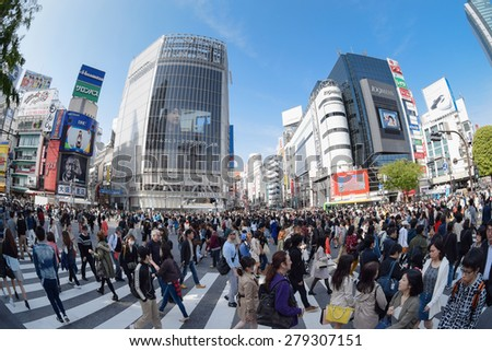 Tokyo, Japan - April 18, 2015: Pedestrians walk at Shibuya district in Tokyo.The scramble crosswalk is one of the largest in the world. - stock photo