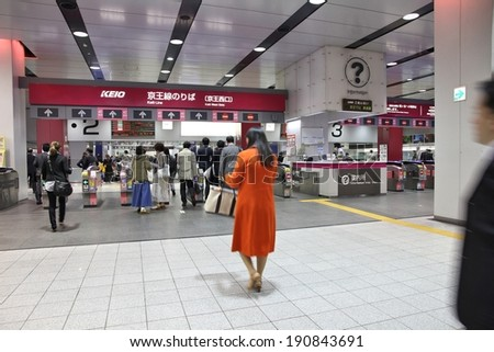 TOKYO, JAPAN - APRIL 13, 2012: People hurry at Shinjuku Station in Tokyo. It is the world's busiest transport hub with daily usage by up to 3.64 million people. - stock photo
