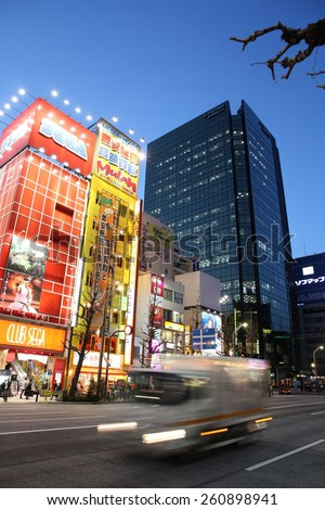 TOKYO, JAPAN - APRIL 12, 2012: People visit Akihabara shopping area in Tokyo. Stores in Akihabara are considered one of best electronics shopping destination in the world (TripAdvisor). - stock photo