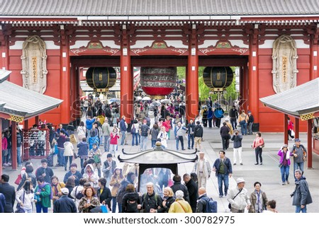 Tokyo, Japan - April 21, 2014: People visiting Sensoji Temple in Asakusa district in Tokyo. Sensoji is Tokyo's oldest temple, and one of its most significant. The temple is dedicated to Kannon. - stock photo