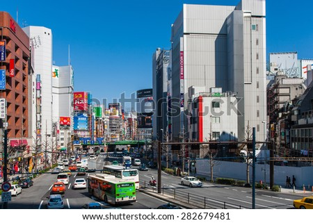 TOKYO, JAPAN - APRIL 4, 2014: Shinjuku District on April 4, 2014 in Tokyo, Japan. Shinjuku is one of the busiest districts of Tokyo, with many international corporate headquarters located here.