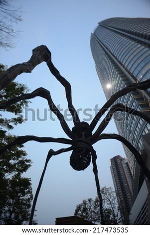 TOKYO JAPAN - APRIL 17 : Spider sculpture in Roppongi Hills on April 17, 2014 in Tokyo, Japan. This spider sculpture is Ronppongi Hills's landmark. - stock photo