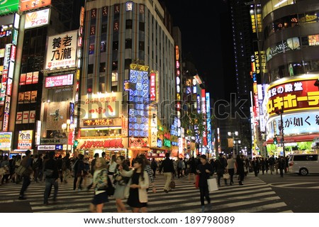 Tokyo, Japan - April 24, 2014 : Tourists and business people crossing the street at Shinjuku intersection - stock photo