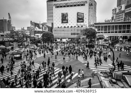 TOKYO, JAPAN - April 14, 2016 - Unidentified pedestrians at Shibuya Crossings in Tokyo. One of the busiest crosswalks in the world (in B&W) - stock photo