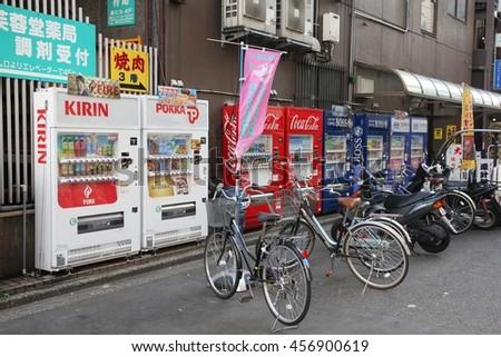 TOKYO, JAPAN - APRIL 12, 2012: Vending machine row in Tokyo, Japan. Japan is famous for its vending machines, with more than 5.5 million machines nationwide. - stock photo