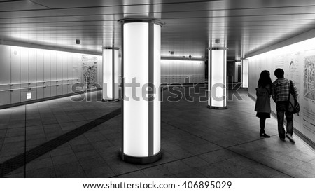 Tokyo, Japan - April 20, 2014: View of Nishi-shinjuku metro station entrance from Nomura Building. Tokyo Metro is a rapid transit system with an average daily ridership of 6.84 million passengers.  - stock photo