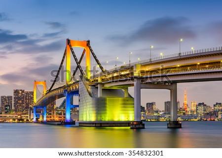 Tokyo, Japan at Rainbow Bridge spanning Tokyo Bay. - stock photo