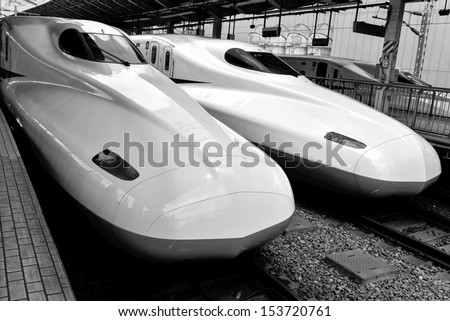 TOKYO, JAPAN - AUGUST 20  Bullet train is arriving into Tokyo station. These high speed trains reaching the speeds over 300Km/h. They are called Shinkansen - stock photo