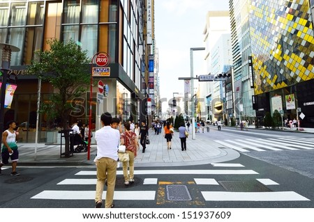 TOKYO, JAPAN - AUGUST 3: Crowds of people crossing the center of Shibuya in August 3 2013, the most important commercial center in Tokyo, Japan  - stock photo