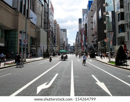 TOKYO, JAPAN- AUGUST 18, 2013: Hokoten or pedestrian paradise, the term is used to refer to streets that are closed off to vehicle traffic on Saturday and Sunday in Ginza area, Japan. August 18 2013