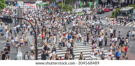 TOKYO, JAPAN - AUGUST 8TH, 2015. Pedestrian crossing the famous Shibuya Crossing. Shibuya is known as one of the fashion centers of Japan, particularly for young people, and as a major nightlife area. - stock photo
