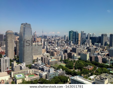 TOKYO, JAPAN - AUGUST 28: View at modern skyscrapers in Roppongi district in Minato, Tokyo at August 28, 2013. This district is well known as the city's most popular nightlife district.