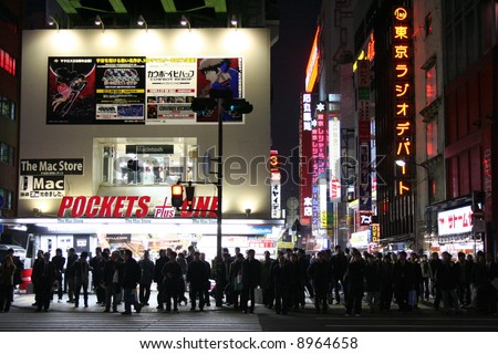TOKYO, JAPAN - Busy intersection in the Akihabara district of Tokyo, Japan. - stock photo