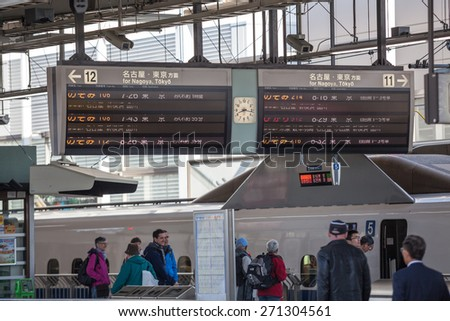 TOKYO, JAPAN - CIRCA APR, 2013: Information board is at the railway station in Tokyo in Japanese language. The Tokyo Station is a railway station in the Marunouchi district of Chiyoda - stock photo